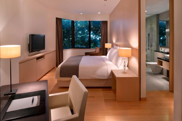 Luxury Singapore hotel suite bedroom