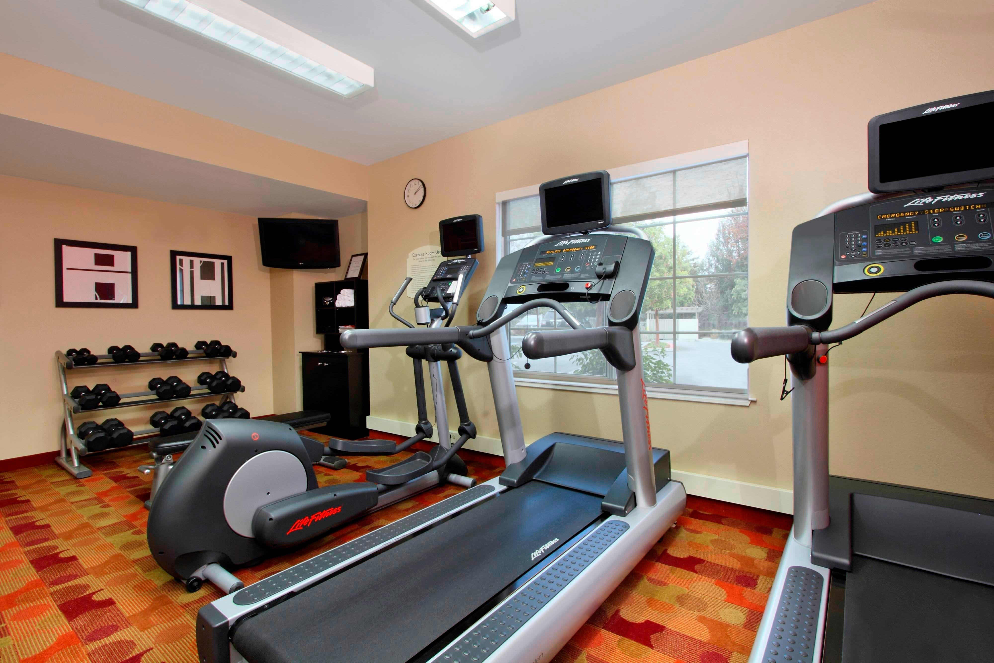 gym, fitness center, treadmill, elliptical, weights