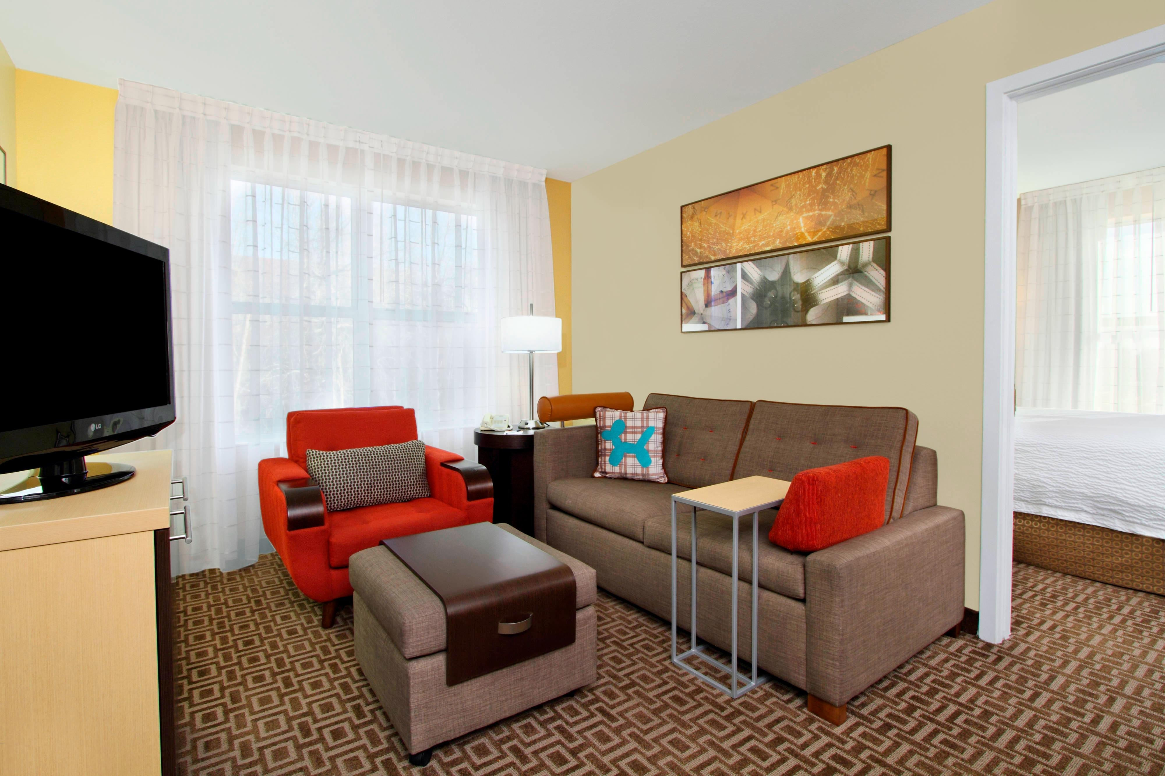 One-Bedroom Suite Sofa, Chair and TV