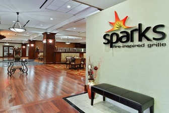Sparks Fire-Inspired Grille Entrance
