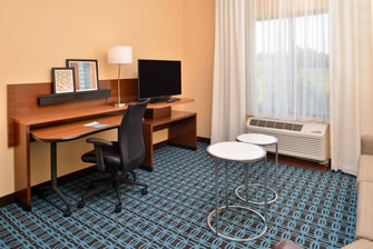Enjoy some TV or catch up on some work at the pull out desk in the two queen beds suite.
