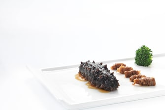 Braised sea cucumber with leek Shandong style