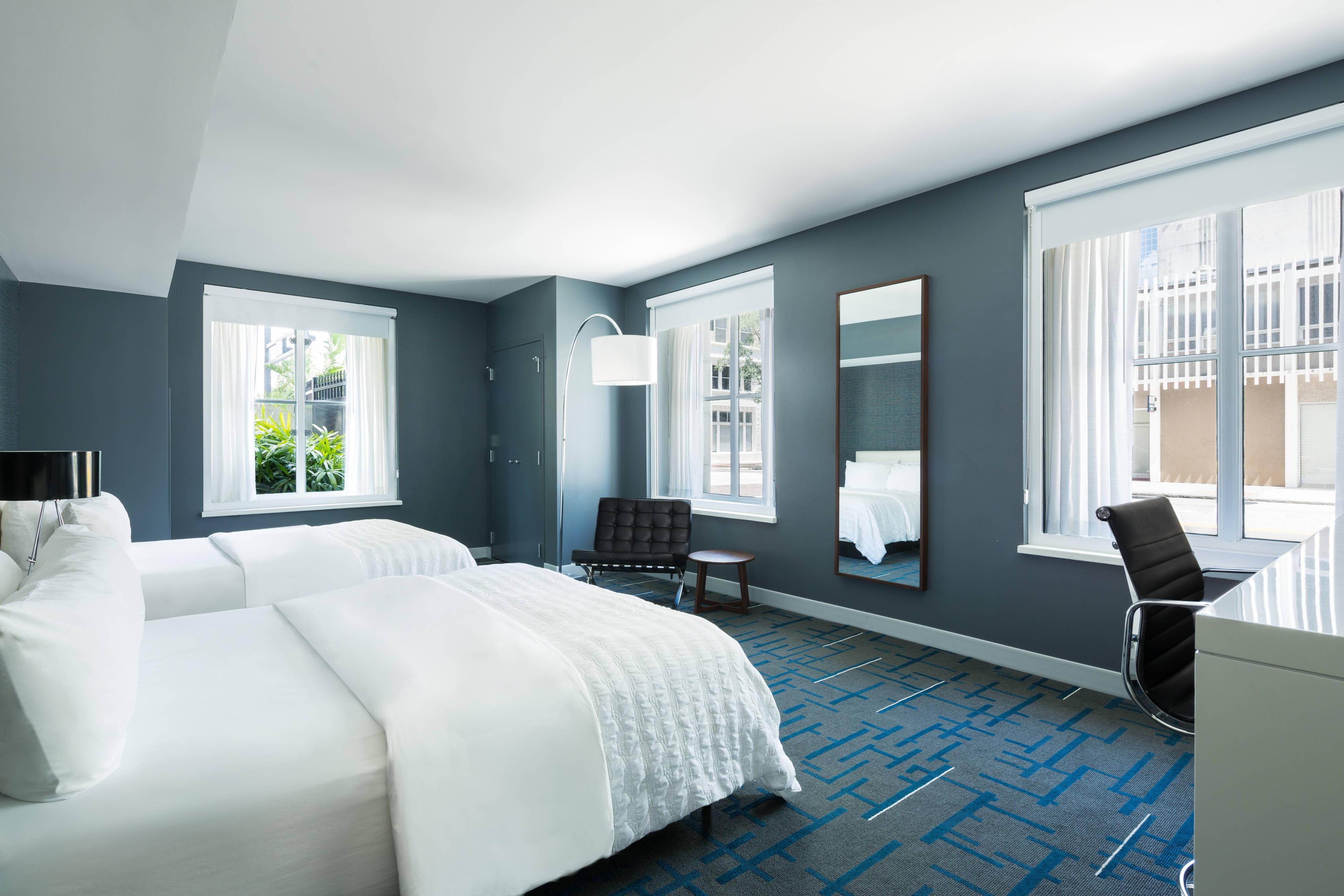 Classic Eckgästezimmer mit zwei Queensize-Betten
