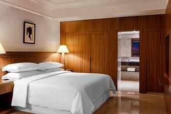 جناح فندقي صغير - غرفة النوم