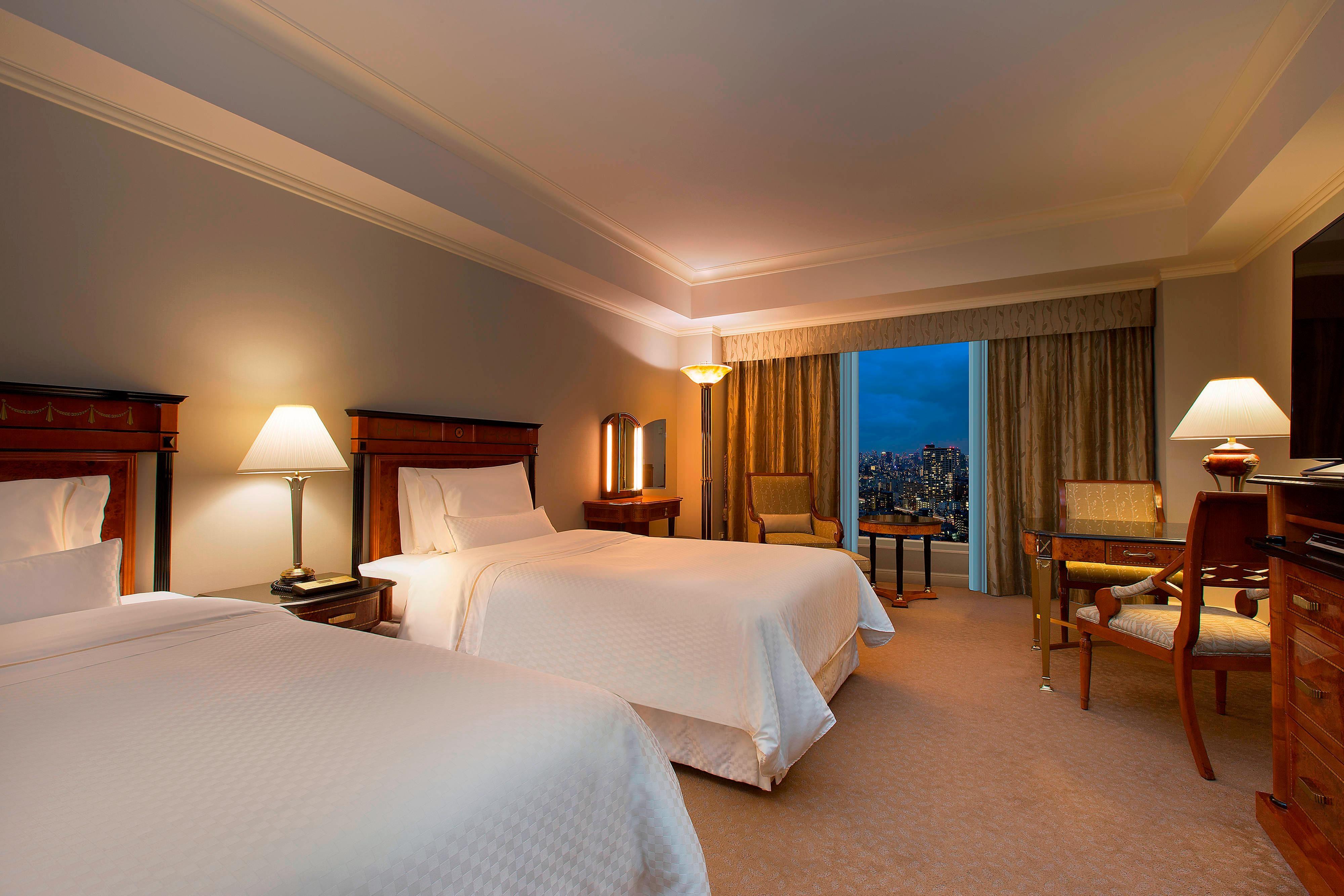 Habitación ejecutiva con dos camas individuales