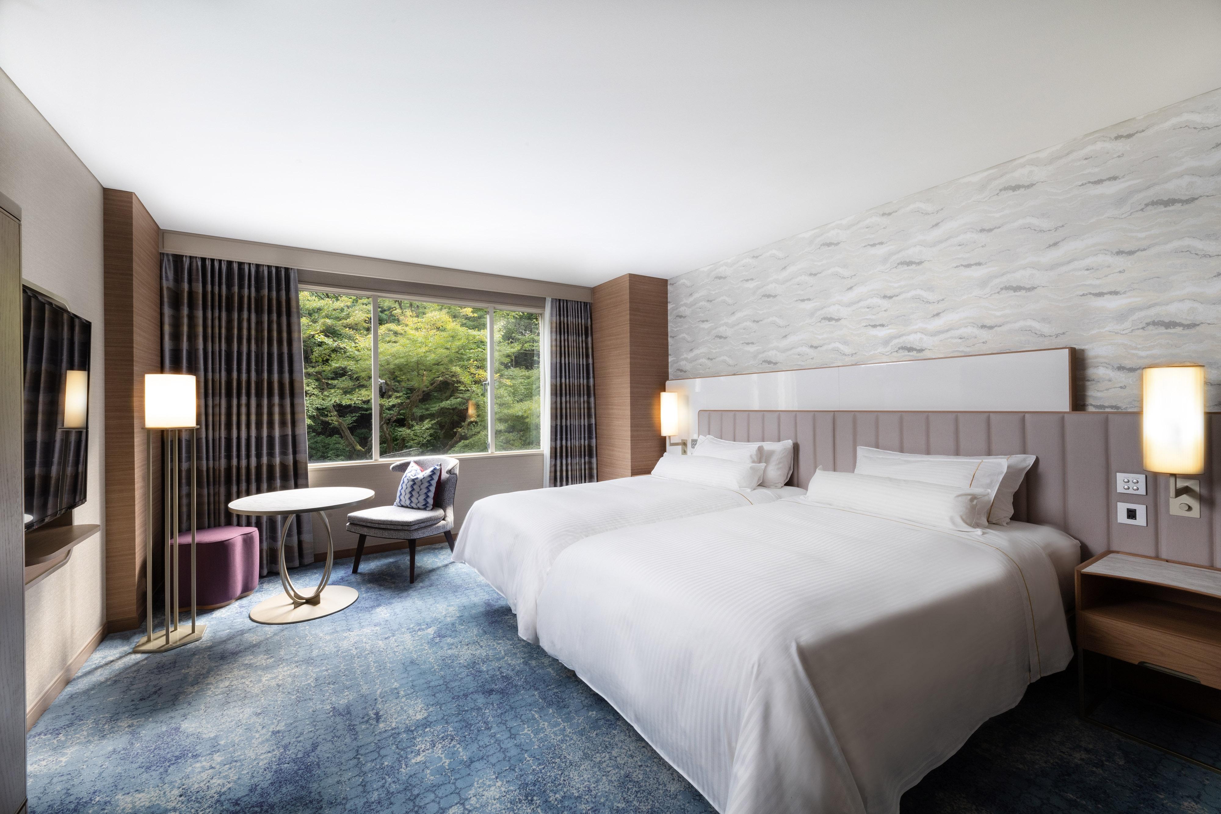 Делюкс с 2односпальными кроватями и видом на сад