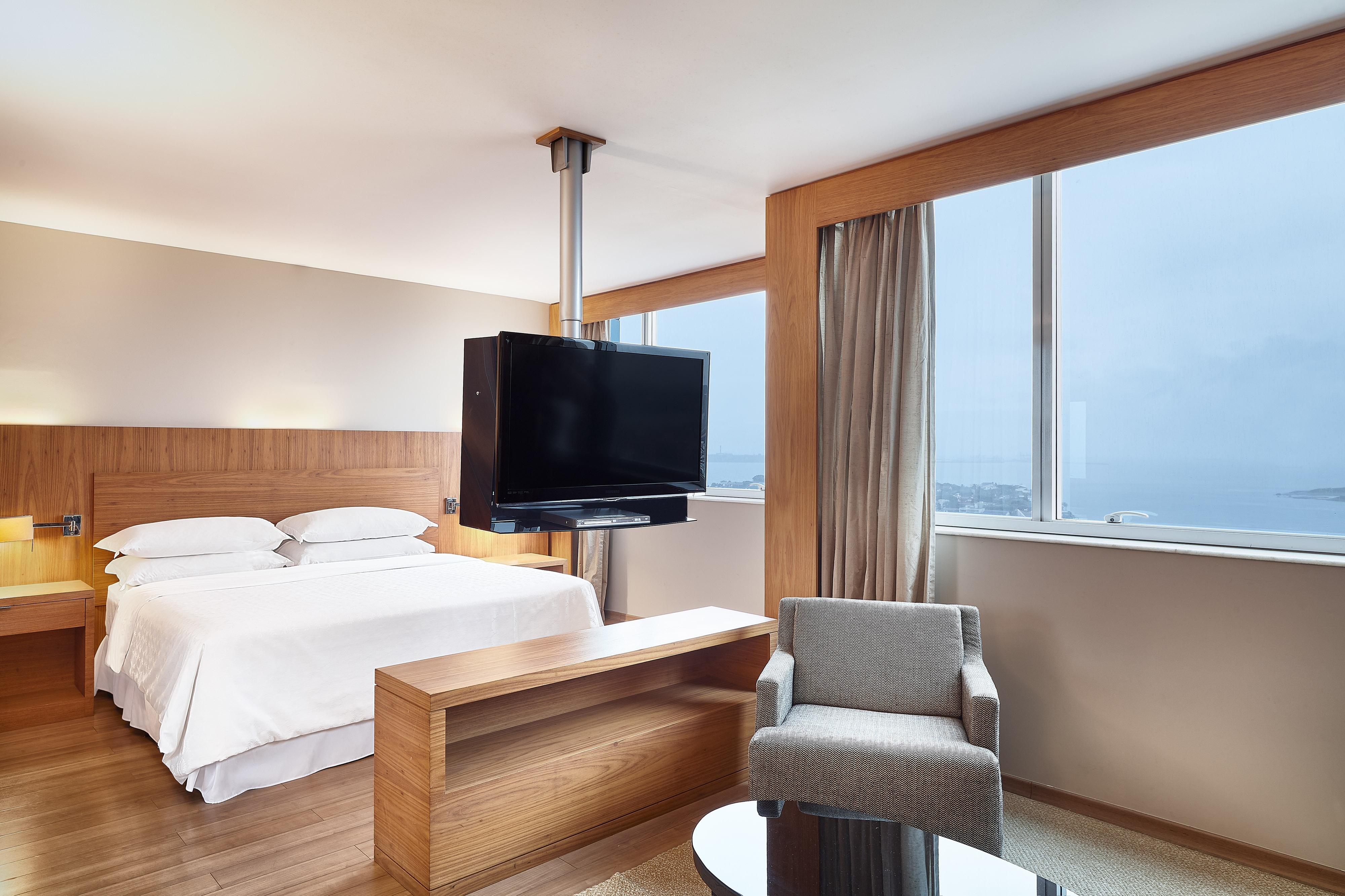 Suite Club avec lit king size et vue sur l'océan