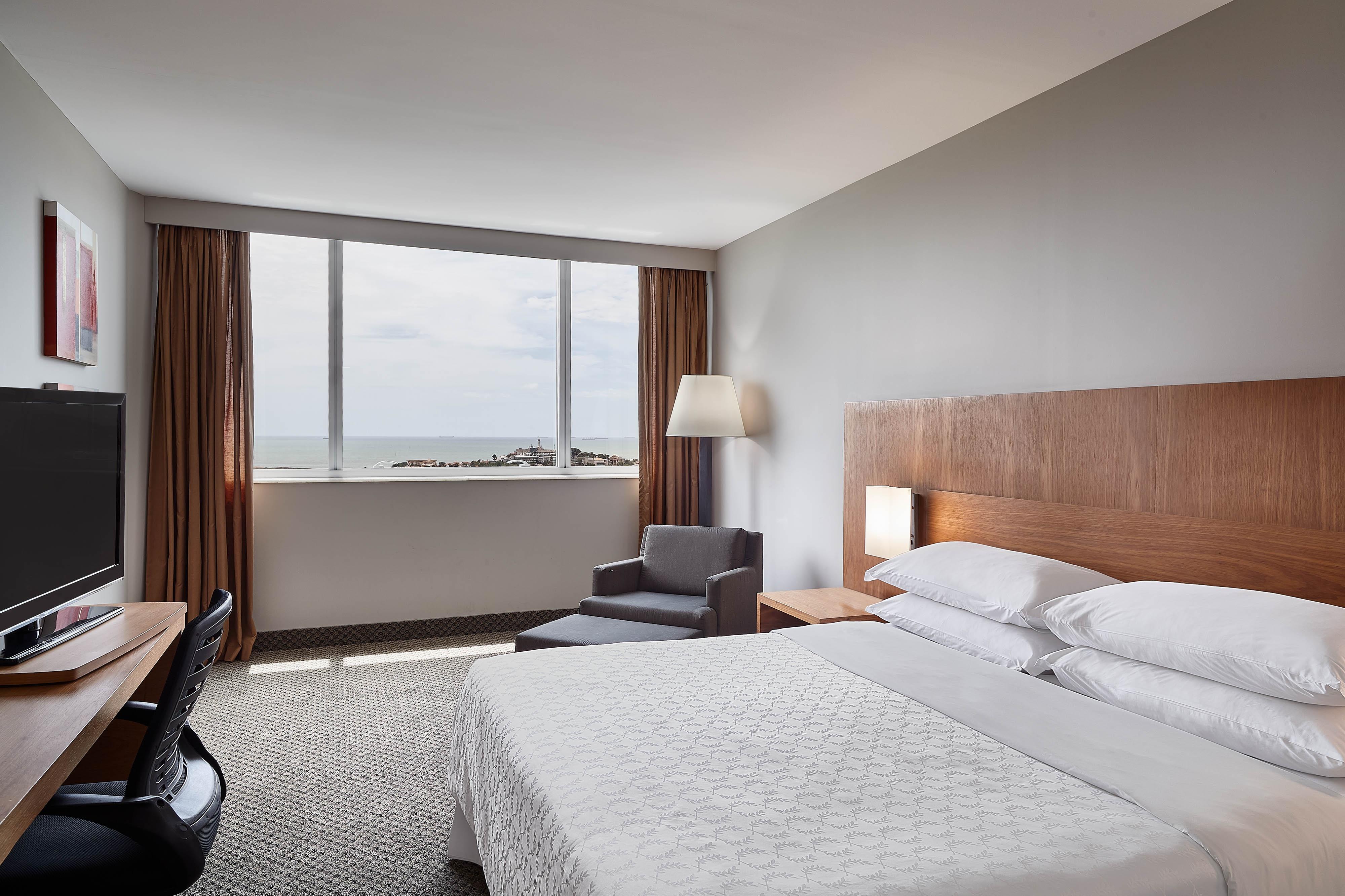 Chambre club Executive avec lit king size et vue sur la mer