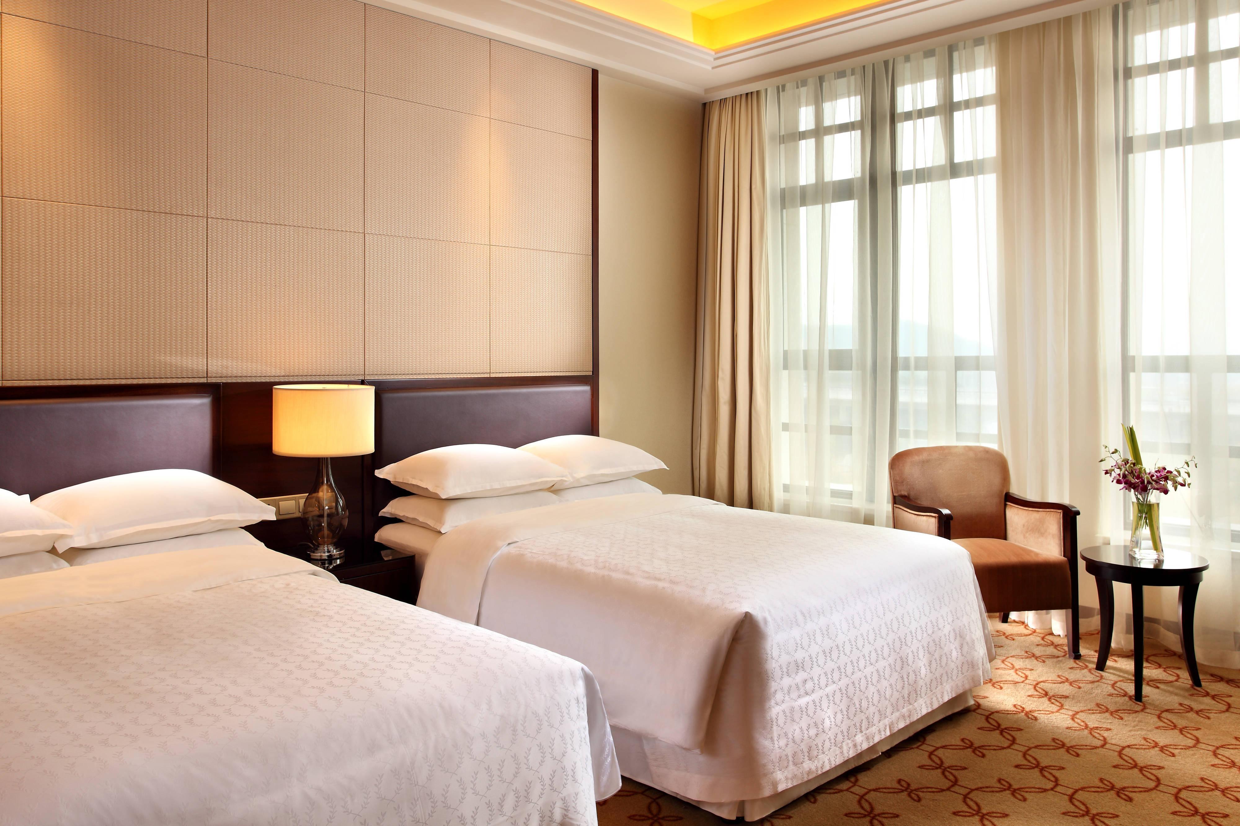Deluxe Gästezimmer mit zwei Einzelbetten