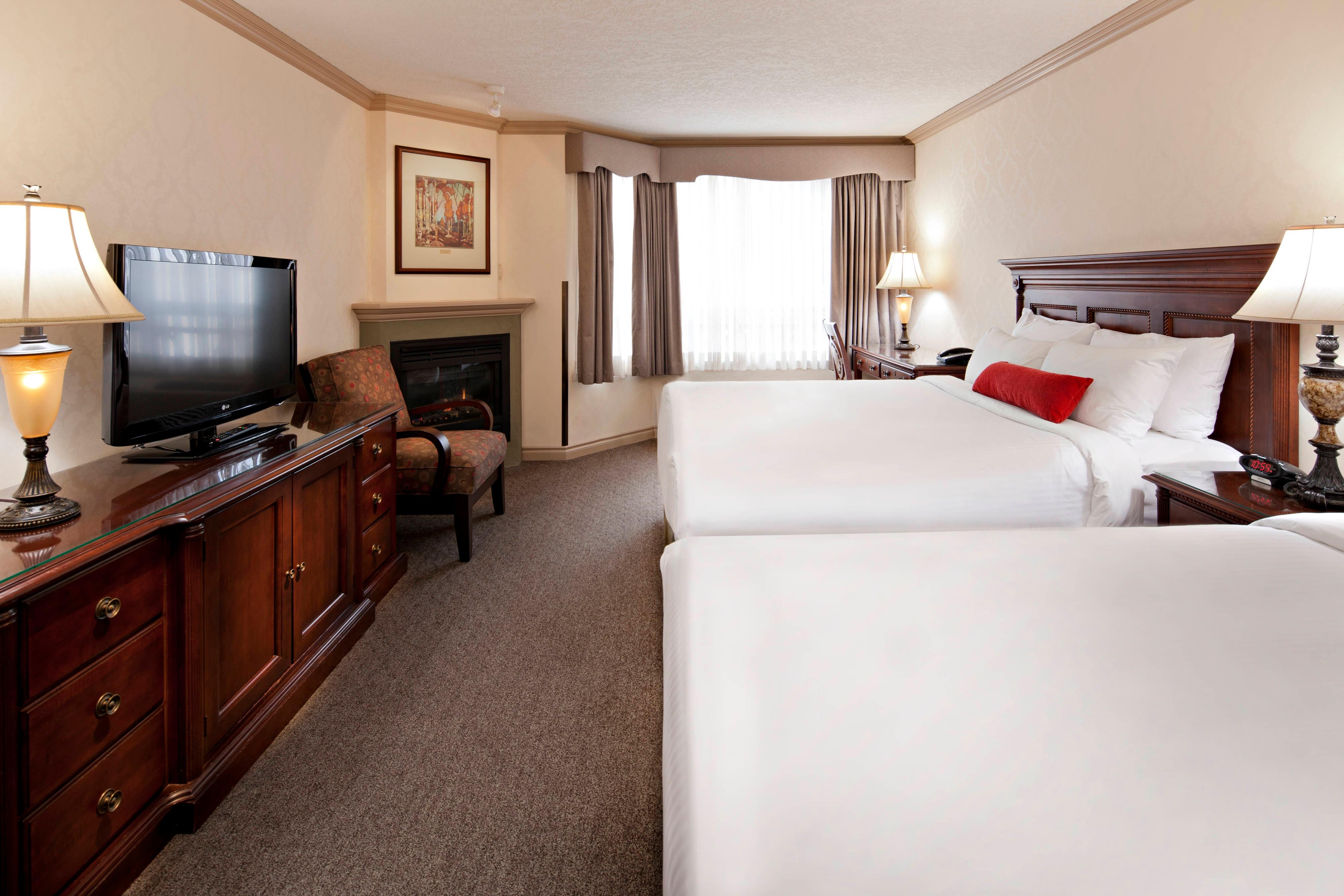 Chambre Premier avec deux lits queen size et cheminée