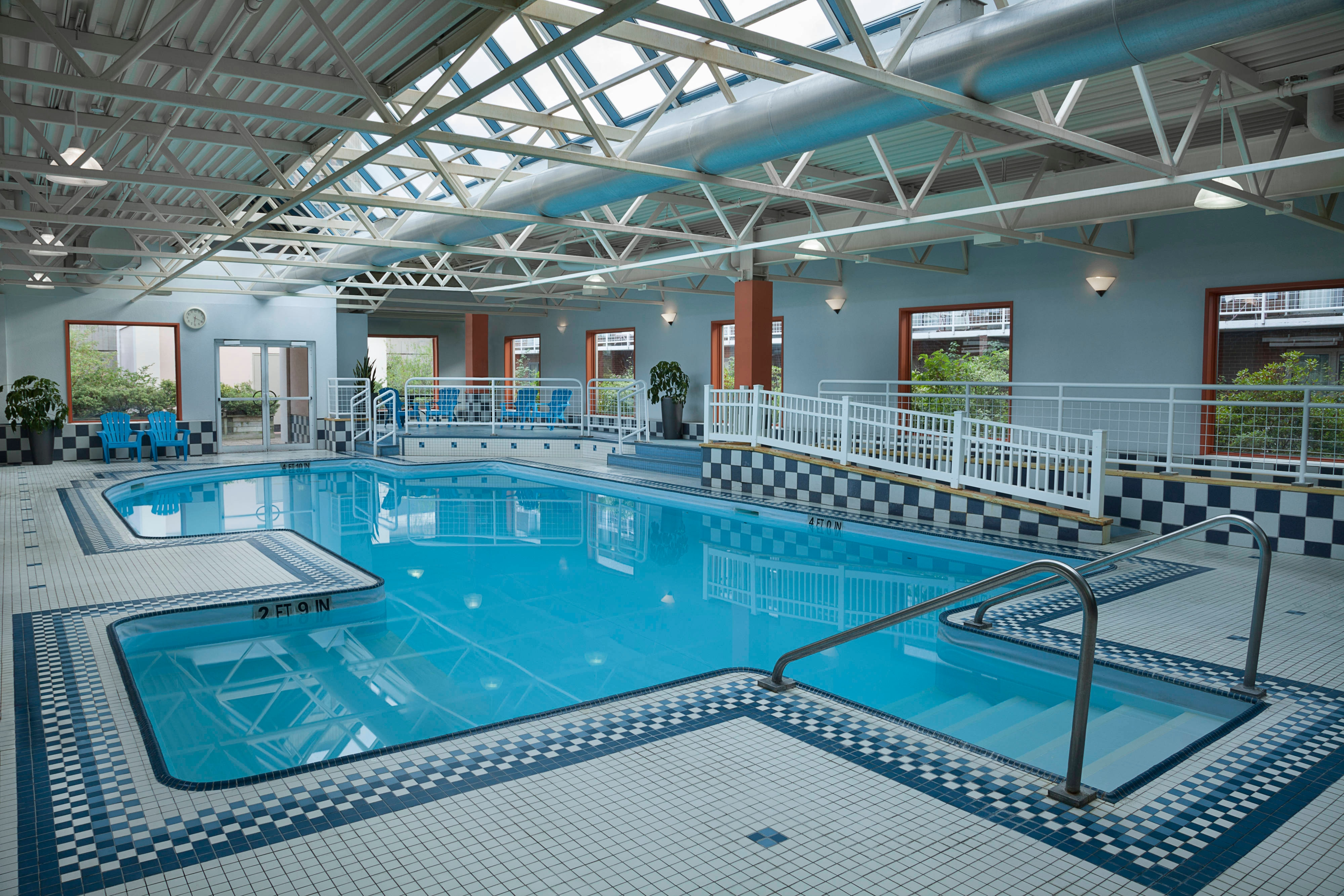 Enjoy our indoor heated pool with access to the rooftop deck.