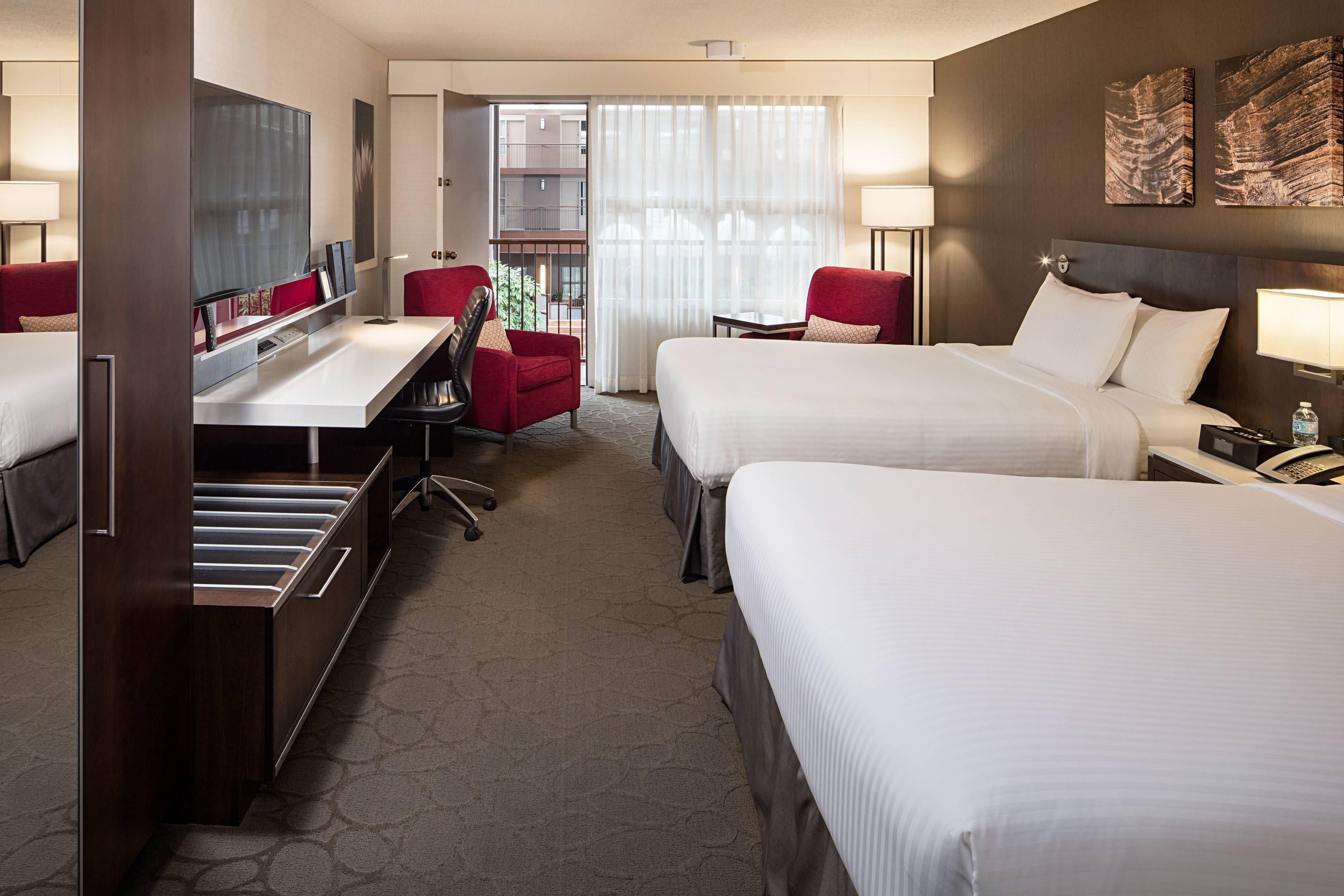Habitación Club Delta con dos camas Queen