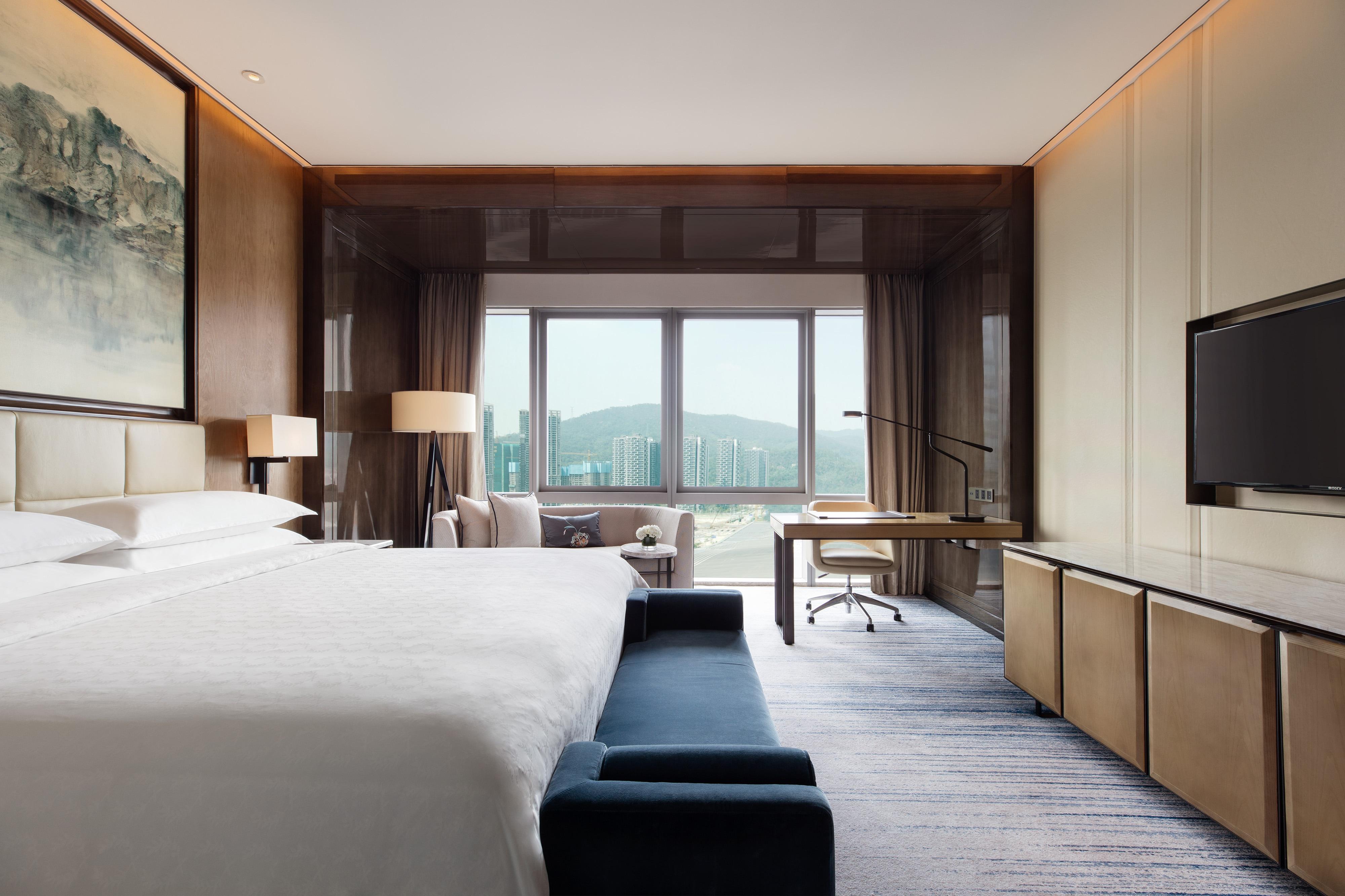 Suite King Ambassador - Dormitorio