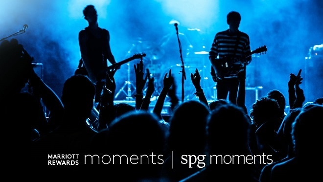 A band plays in front of crowd. Marriott Rewards Moments and SPG Moments logos