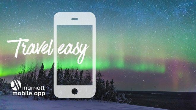 Northern Lights sky. Travel easy. Marriott Mobile App logo.