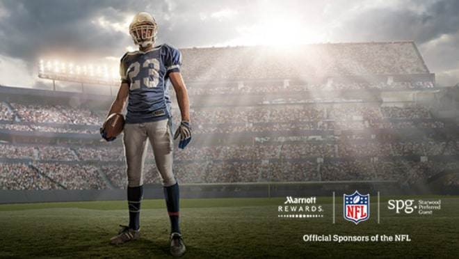 Football player stands on stadium field. Marriott Rewards, NFL and Starwood logos.