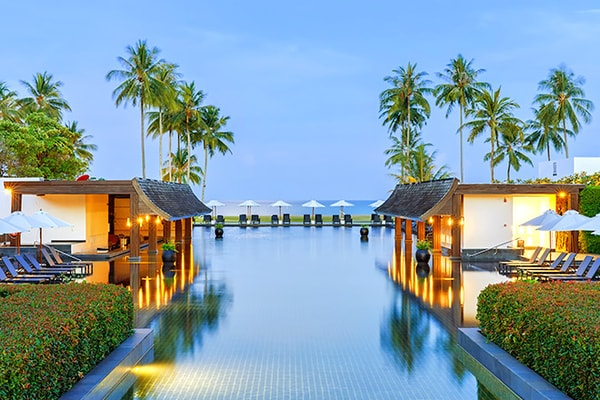 Tropical resort outdoor swimming pool and lounge area